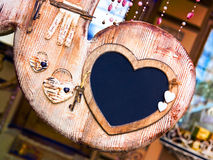 Valentine wooden frame with keys to the heart. And empty blackboard stock image