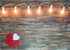 Valentine wooden textured background with light garland Royalty Free Stock Photo