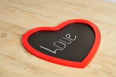 Valentine& x27 ; jour de s Un conseil de noir de forme de coeur Photo libre de droits