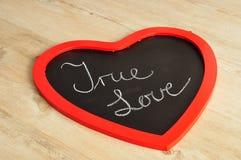 Valentine& x27 ; jour de s Un conseil de noir de forme de coeur Photographie stock