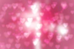Valentine& x27; s-Tageshintergrund unscharfes bokeh mit Herzen bokeh Art kopieren Sie Raum für das Addieren Ihres Textes oder ver Stockbilder