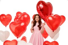 Free Valentine& X27;s Day. Beauty Girl Holding Red Air Balloons, Symbols Of Love. Happy Young Woman Laughing. Model Having Fun Royalty Free Stock Photo - 186902845
