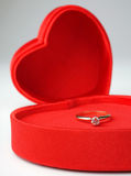 Valentines. Close-up view of valenting box with diamond solitaire ring inside Stock Image