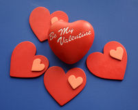 Valentines. Be my valentine heart with smaller red hearts on blue background Royalty Free Stock Images