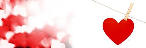 Valentines accrochant le coeur et le fond de coeurs d'amour Photos libres de droits