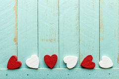 Valentines background. Valentines hearts on wooden background Royalty Free Stock Image