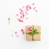 Valentines background. Petals of roses and vintage paper cards, gift box  on white background. Flat lay, Top view. Stock Image