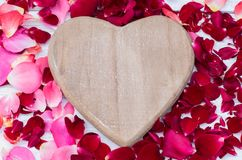 Valentines Background, wooden heart, roses petals, Valentine day love. Valentines Background, wooden heart, roses petals Valentine day love. Top view with copy Royalty Free Stock Photos
