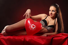 Valentines beauty girl with balloon heart in her hands Royalty Free Stock Photo