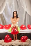 Valentines beauty girl with baloon in sleeping room Stock Images