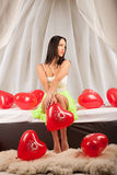 Valentines beauty girl with baloon in sleeping room Royalty Free Stock Photo