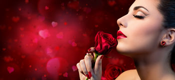 Valentines Beauty - Sensual Model Woman. Touching Red Rose Flower Stock Photos
