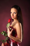 Valentines beautyfull girl with red rose in her hands Stock Images