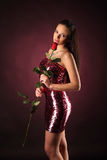 Valentines beautyfull girl with red rose in her hands Royalty Free Stock Photography