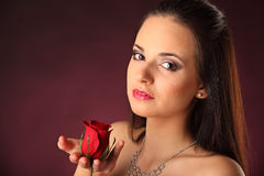 Valentines beautyfull girl with red rose in her hands Royalty Free Stock Photos