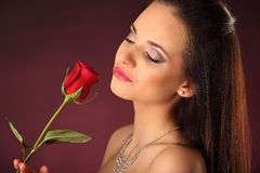 Valentines beautyfull girl with red rose in her hands Royalty Free Stock Images