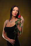 Valentines beautyfull girl with red rose in her hands Stock Photo