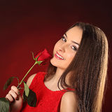 Valentines beautyfull girl with red rose in her hands Royalty Free Stock Photo