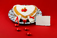 Valentines cake on the red background Royalty Free Stock Image