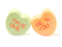 Valentines candies. Heart-shaped Valentines Day candies with phrases TRUE ONE and ME & YOU Stock Image