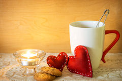 Valentines with candle and cup of tea Stock Photo