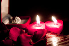 Valentines candles. On rose petals background Royalty Free Stock Photos