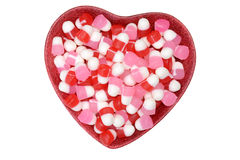 Valentines candy in heart bowl. On white background stock images