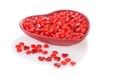 Valentines candy in a red heart bowl Stock Images
