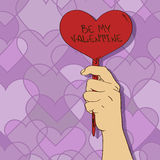 Valentines card with hand of man holding heart pla Royalty Free Stock Photo