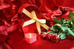 Valentines card with red roses. Valentine Heart Shape Gift Box and burning candles Royalty Free Stock Photography