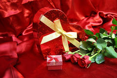 Valentines card with red roses. Valentine Heart Shape Gift Box and burning candles Royalty Free Stock Photos
