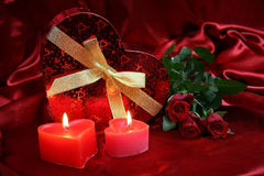 Valentines card with red roses IV. Valentine Heart Shape Gift Box and burning candles Royalty Free Stock Image