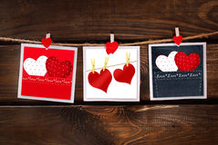 Valentines cards hanging on wooden background Royalty Free Stock Images