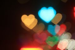 Valentines Colorful heart-shaped on black background lighting bokeh for decoration at night backdrop wallpaper blurred valentine. The Valentines Colorful heart Stock Photos