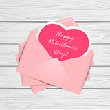 Valentines congratulations on wooden background Royalty Free Stock Image