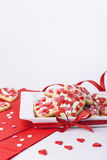 Valentines cookies with hearts in square dish. Valentine cookies on white plate and red napkins Stock Photos