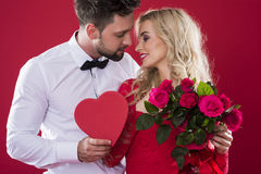 Valentines couple. Romantic scene on the red background Stock Images