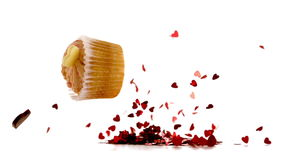 Valentines cupcakes falling on piles confetti stock footage