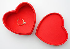 Valentines day. Heart-shaped valentines day box with a diamond solitaire ring in it on white background seen from above Stock Photography