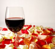 Valentines day. Wine glasses on flower petals for valentines day Royalty Free Stock Images