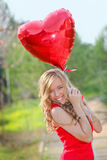 Valentines day. Happy Valentines day woman with heart balloons Royalty Free Stock Image