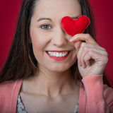 Valentines day. Beautiful young woman holding red heart on Valentines day Royalty Free Stock Photography