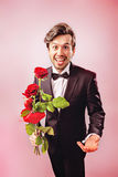 Valentines Day. Man in love over the moon with roses Royalty Free Stock Photo