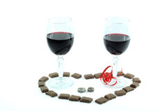 Valentines Day Arrangement. Wine, Chocolate, Rings and Symbolic heart over white background. Symbols of Valentines Day Stock Photos