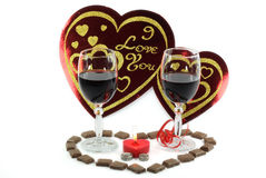 Valentines Day Arrangement. Wine, Chocolate, Rings and Symbolic heart over white background. Symbols of Valentines Day Royalty Free Stock Photos