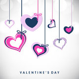 Valentines Day background. Valentines Day greeting card or gift card with hanging colorful hearts with ribbon on grey background, love concept. EPS 10 Royalty Free Stock Image