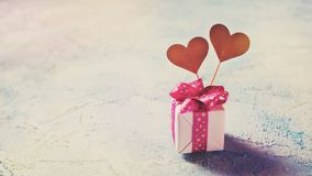 Valentines day background. Box of gift with  two hearts over blu Stock Photo
