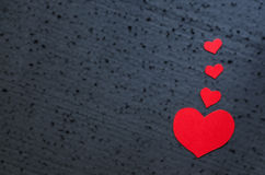 Valentines day background - bright red hearts on a black backgro Royalty Free Stock Photography