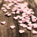 Valentines Day background with candy hearts. Sugar Hearts on woo Royalty Free Stock Photo