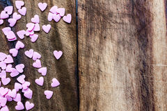 Valentines Day background with candy hearts. Sugar Hearts on woo Royalty Free Stock Photography